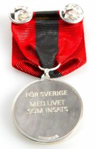 Försvarsmaktens medalj för sårade i strid (baksidan)